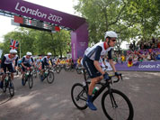 Britain`s Bradley Wiggins leads his teammates as they start the Men`s Road Cycling race at the 2012 Summer Olympics in London.