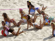Dancers perform at the Beach Volleyball Venue at the 2012 Summer Olympics in London.