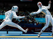 Natalia Sheppard of Great Britain, left and Sophie Troiano of Great Britain compete in the of round 64 during women`s fencing at the 2012 Summer Olympics in London.