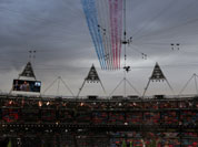 The Red Arrows flies over the stadium during the Opening Ceremony at the 2012 Summer Olympics in London.