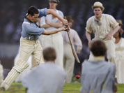Performers play a game of cricket during the Opening Ceremony at the 2012 Summer Olympics in London.