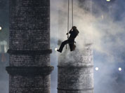 An artist is lowered down during the Opening Ceremony at the 2012 Summer Olympics in London.