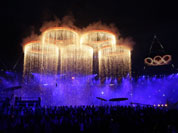 The Olympic rings are lit with pyrotechnics during the Opening Ceremony at the 2012 Summer Olympics in London.