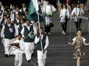 Pakistan`s Sohail Abbas carries the flag during the Opening Ceremony at the 2012 Summer Olympics in London.