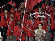 Trinidad & Tobago`s Marc Burns carries the flag during the Opening Ceremony at the 2012 Summer Olympics in London.