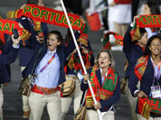 Portugal`s Telma Monteiro carries the flag during the Opening Ceremony at the 2012 Summer Olympics in London.