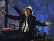Paul McCartney performs during the Opening Ceremony at the 2012 Summer Olympics in London.