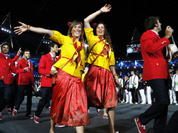 Athletes from Spain wave to spectators as they parade during the Opening Ceremony at the 2012 Summer Olympics in London.