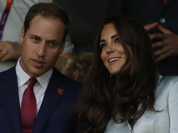 Britain`s Catherine, Duchess of Cambridge, and Britain`s Prince William, the Duke of Cambridge attend the Opening Ceremony at the 2012 Summer Olympics in London.