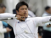South Korea`s Oh Jin-hyek aims for the target during an individual ranking round at the 2012 Summer Olympics in London.