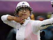 South Korea`s Lee Sung-jin aims for the target during an individual ranking round at the 2012 Summer Olympics in London.