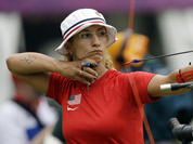 United State`s Khatuna Lorig releases her arrow during an individual ranking round at the 2012 Summer Olympics in London.