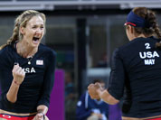 Misty May-Treanor, right, and Kerri Walsh, left, of US celebrate winning a point against Australia in their Beach Volleyball match at the 2012 Summer Olympics in London.