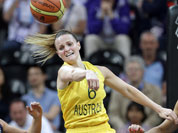 Australia`s Jennifer Screen (6) passes the ball past Great Britain`s Johannah Leedham (13)during the first half of a preliminary women`s basketball game at the 2012 Summer Olympics in London.