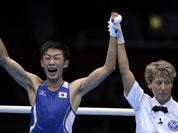 Japan`s Satoshi Shimizu reacts after defeating Ghana`s Isaac Dogboe in a bantam weight 56-kg preliminary boxing match at the 2012 Summer Olympics in London.