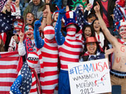 US supporters cheer during the group G women`s soccer match between the United States and Colombia at the London 2012 Summer Olympics  at Hampden Park Stadium in Glasgow, Scotland.