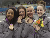 Members of the US women`s relay team, from left, Lia Neal, Allison Schmitt, Jessica Hardy and Missy Franklin pose with their bronze medals in the women`s 4x100-meter freestyle relay swimming final at the Aquatics Centre in the Olympic Park during the 2012 Summer Olympics in London.