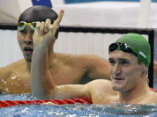 South Africa`s Cameron van der Burgh waves as Japan`s Kosuke Kitajima looks on after their men`s 100 meters breaststroke semifinal at the Aquatics Centre in the Olympic Park during the 2012 Summer Olympics in London.