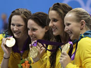 From left, Australia`s Alicia Coutts, Cate Campbell, Brittany Elmslie and Melanie Schlanger pose with their gold medals for the women`s 4x100-meter freestyle relay swimming final at the Aquatics Centre in the Olympic Park during the 2012 Summer Olympics in London.