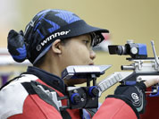Malaysian shooter Nur Suryani Mohamed Taibi, who is eight months pregnant, competes in the qualifiers for the women`s 10-meter air rifle event, at the 2012 Summer Olympics in London.