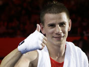 Serbia`s Aleksandar Drenovak reacts after a middle weight 75-kg preliminary boxing match against Ecuador`s Mario Delgado Suarez at the 2012 Summer Olympics in London.