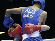Australia`s Jess Ross fights Algeria`s Abelmalek Rahou, right, during a middle weight 75-kg preliminary boxing match at the 2012 Summer Olympics in London.
