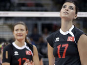 Turkey`s Neslihan Darnel, right, reacts near teammate Neriman Ozsoy, left, after hitting the ball into the net on a serve during a women`s preliminary volleyball match against Brazil at the 2012 Summer Olympics in London. 