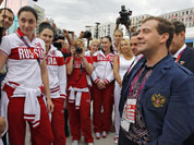 Russian Prime Minister Dmitry Medvedev, right, speaks with Russian Olympics team members during his visits to Olympic village at the 2012 Summer Olympics, in London.