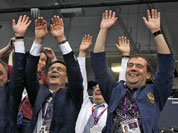 Russian Prime Minister Dmitry Medvedev, right, Deputy Prime Minister and Russia`s Olympic Committee president Alexander Zhukov, center, and Sports Minister Vitaly Mutko, left, react during a women`s preliminary volleyball match between Britain and Russia at the 2012 Summer Olympics, in London.
