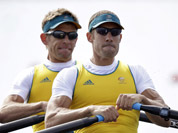 Australia`s Scott Brennan, and David Crawshay stroke during a men`s rowing double sculls repechage in Eton Dorney, near Windsor, England, at the 2012 Summer Olympics.