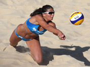 Marta Menegatti from Italy dives for a ball during the Beach Volleyball match against Russia at the 2012 Summer Olympics in London.
