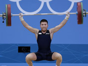 Italy`s Mirco Scarantino lifts during the men`s 56-kg, group B, weightlifting competition at the 2012 Summer Olympics in London.
