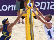 Pablo Allepuz Herrera, left, from Spain fights for a ball with Premysl Kubala, right, from Czech Republic during their Beach Volleyball match at the 2012 Summer Olympics in London.