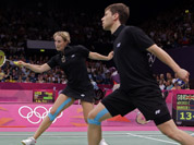 Germany`s Birgit Michels, left, and Michael Fuchs play against Chris Adcock and Imogen Bankier of Great Britain during a mixed doubles badminton match at the 2012 Summer Olympics in London. 