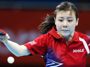 Ariel Hsing of the United States compets against Yifang Xian of France during the second round of women`s table tennis at the 2012 Summer Olympics in London.