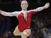 Gymnast Gaelle Mys from Belgium performs on the balance beam during the Artistic Gymnastics women`s qualification at the 2012 Summer Olympics in London. 
