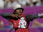 Deepika Kumari shoots during the women`s archery team competition at the 2012 Summer Olympics in London.