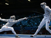 Germany`s Nicolas Limbach, right, and Poland`s Adam Skrodzki compete during the men`s individual sabre round of 32 fencing at the 2012 Summer Olympics in London.