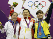 Gold medalist, China`s Guo Wenjun celebrates with silver medalist, France`s Celine Goberville and bronze medalist Olena Kostevych of Ukraine following the final in the women`s 10-meter air pistol event at the 2012 Summer Olympics in London.