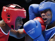 Wellington Arias Romero of the Dominican Republic lands a punch against Colombia`s Eduar Marriaga Campo during men`s light 60-kg boxing at the 2012 Summer Olympics in London.