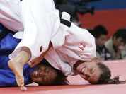 Luxembourg`s Marie Muller, right, competes with Mauritius`s Christianne Legentil during the women`s 52-kg judo competition at the 2012 Summer Olympics in London.