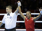 Puerto Rico`s Felix Verdejo Sanchez,  reacts after beating Panama`s Juan Huertes Garcia, during their men`s light 60-kg boxing match at the 2012 Summer Olympics in London.