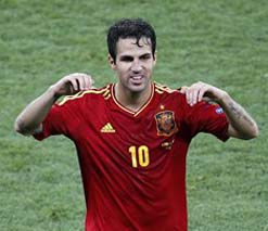 Fabregas credits being bunch of normal players for Spains spectacular success	