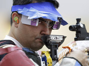 Gagan Narang shoots during qualifiers for the men`s 10-meter air rifle event at the 2012 Summer Olympics in London.