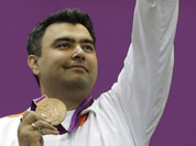 Gagan Narang celebrates winning the bronze medal in the men`s 10-meter air rifle at the 2012 Summer Olympics in London.
