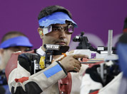 Gagan Narang shoots during the men`s 10-meter air rifle final at the 2012 Summer Olympics in London. Gagan placed third to win the bronze medal.