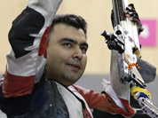 Gagan Narang celebrates winning the bronze medal at the end of the men`s 10-meter air rifle at the 2012 Summer Olympics in London.