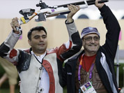 Gagan Narang,  celebrates winning the bronze medal in the men`s 10-meter air rifle, with his coach Stanislav Lapidus, at the 2012 Summer Olympics in London.