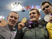United States` Brendan Hansen, left, South Africa`s Cameron van der Burgh, center, and Australia`s Christian Sprenger pose with their medals for the men`s 100-meter breaststroke swimming final at the Aquatics Centre in the Olympic Park during the 2012 Summer Olympics.