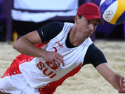 Jefferson Bellaguarda from Switzerland dives for a ball during the Beach Volleyball match against Italy at the 2012 Summer Olympics.